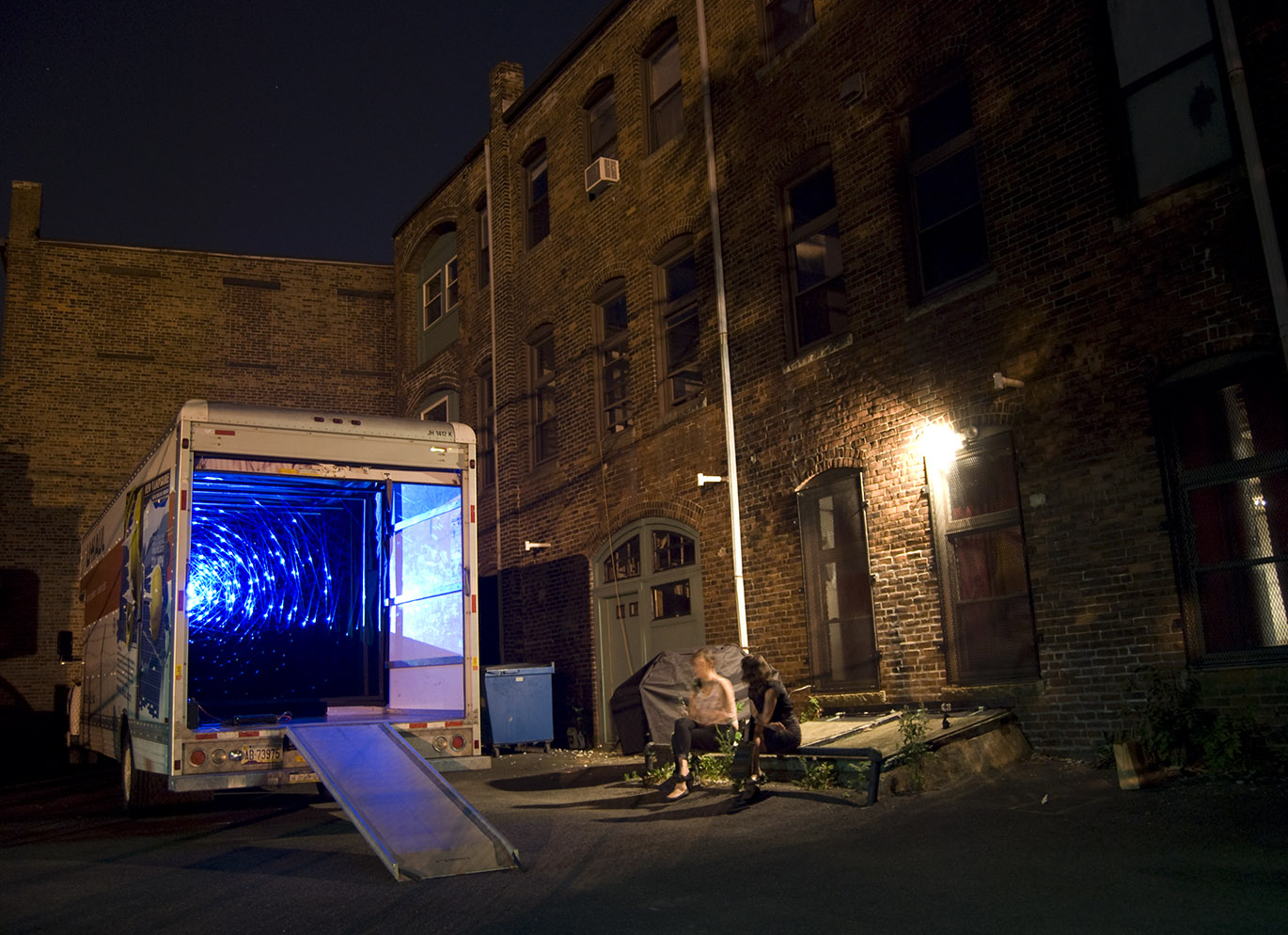 Phototrop, 2012, collaboration with Vela Phelan, Part of the White Walls Boston. Video projected in a U-Haul Truck, projection, ice blue fishing line, duvateen, wood. Five different locations around Cambridge and Boston, MA